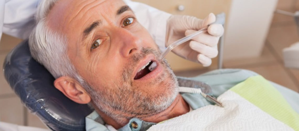 dentist-examining-patients-teeth-dentists-chair_13339-209116